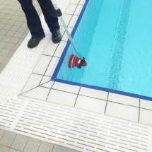 cleaning walls of the pool with motor scrubber نظافت دیواره استخر با اسکرابر چند منظوره