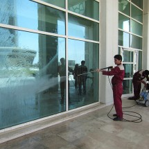 washing and cleaning the facade of the building شستشو و نظافت نمای ساختمان